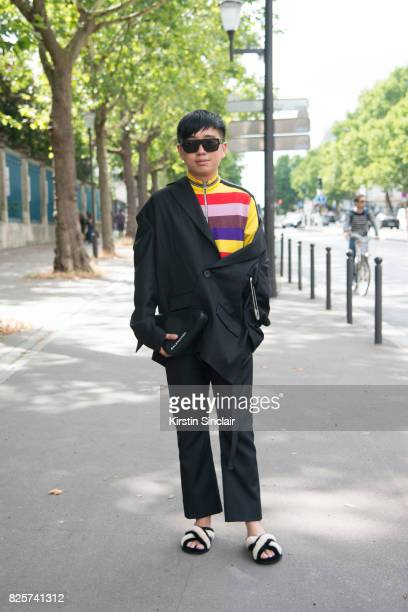 Fashion stylist and style director Declan Chan wearing a R Shemiste jacket Loewe sweater Avec moderation shoes Balenciaga trousers and bag day 1 of...
