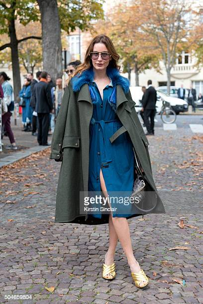 Fashion stylist and writer Ece Sukan wears a Mr and Mrs Italy trench coat Tod's bag Gucci shoes umitbenan plus one dress on day 9 during Paris...