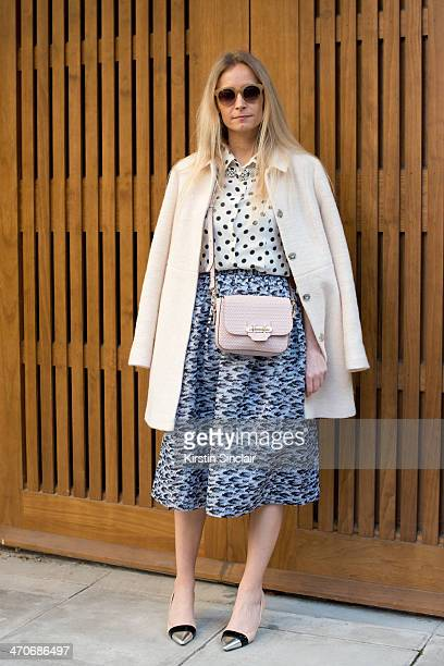 Fashion Stylist and writer Martha Ward wears a Whistles skirt Prada shirt Topshop coat Nicholas Kirkwood shoes J Crew necklace and a Todds Handbag on...