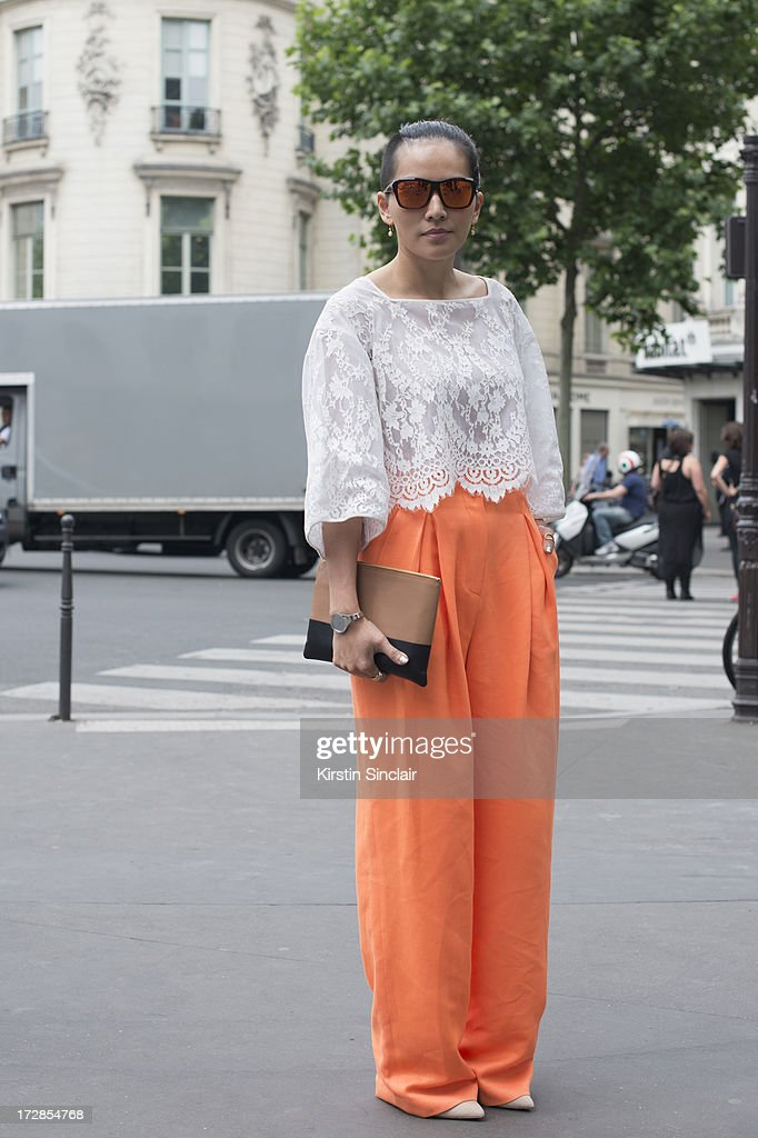Fashion Stylist and writer Tina Leung wears Push button top and trosuers, Celine bag and Sunpocket sunglasses on day 2 of Paris Collections: Womens Haute Couture on July 02, 2013 in Paris, France.