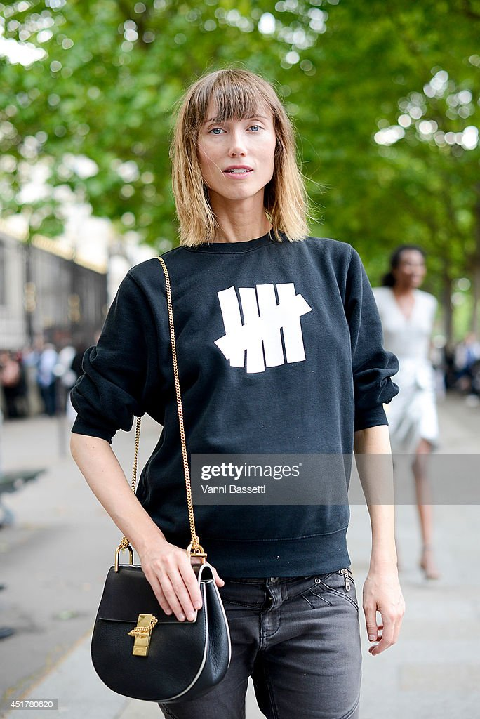 Fashion stylist Anya Ziourova poses wearing an Undefeated sweater and Chlo bag after Atelier Versace show on July 6, 2014 in Paris, France.