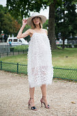 Fashion Stylist Anya Ziourova wearing an Issa dress Pierre Hardy shoes and Eugenia Kim hat day 3 of Paris Haute Couture Fashion Week Autumn/Winter...