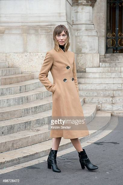 Fashion Stylist Anya Ziourova wears a Stella McCartney jacket and boots on day 7 during Paris Fashion Week Spring/Summer 2016/17 on October 5 2015 in...
