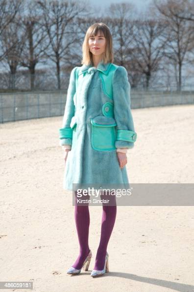 Fashion Stylist Anya Ziourova wears Delpozo shoes Kotur bag and Miu Miu coat on day 5 of Paris Collections Women on March 01 2014 in Paris France