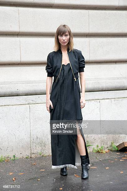 Fashion Stylist Anya Ziourova wears The Kayys dress and jacket with Stella McCartney boots on day 7 during Paris Fashion Week Spring/Summer 2016/17...