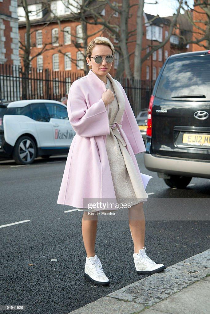 Fashion stylist Aram Kabbani wears a Max Mara coat Dior bag Balenciaga shoes Dior Glasses and Topshop unique dress on February 24 2015 in London...