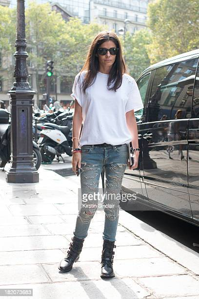 Fashion Stylist Barbara Martelo wears Saint Laurent jeans Balmains T shirt and Ray Ban sunglasses on day 3 of Paris Fashion Week Spring/Summer 2014...
