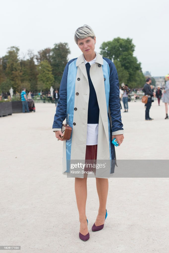 Fashion stylist Elisa Nalin wearing a Lahssan coat, Pierre Hardy shoes, Catherine Langer bag and a Paul Ka skirt on day 8 of Paris Fashion Week Spring/Summer 2014, Paris October 01, 2013 in Paris, France.