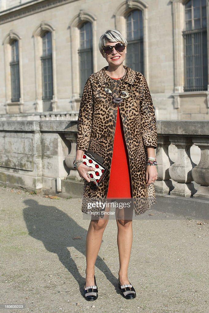 Fashion stylist Elisa Nalin wearing a No 21 jacket Paule Ka dress, shoes and necklace, Karen Walker sunglasses and a Roger Vivier bag on day 9 of Paris Fashion Week Spring/Summer 2014, Paris October 02, 2013 in Paris, France.