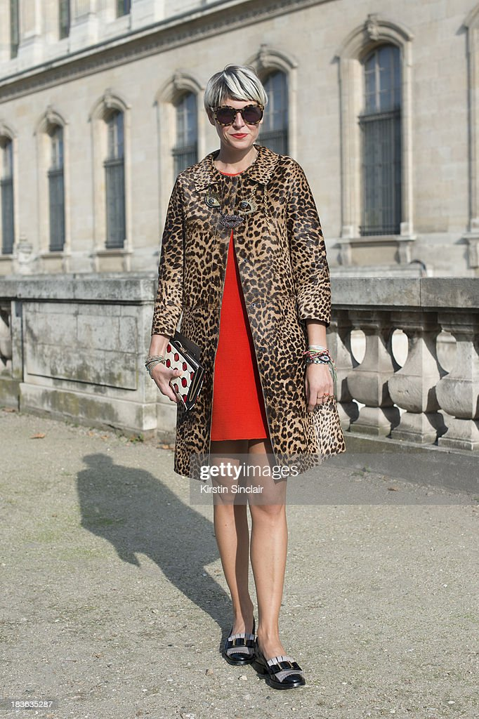 Fashion stylist Elisa Nalin wearing a No 21 jacket Paule Ka dress, shoes and necklace, Karen Walker sunglasses and a Roger Vivier bag on day 9 of Paris Fashion Week Spring/Summer 2014, Paris October 02, 2013 in Paris, France.