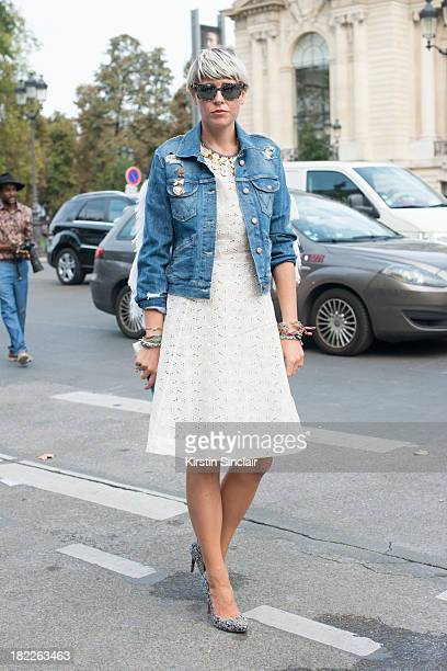 Fashion stylist Elisa Nalin wears Micheala Birger jacket and a Ventillo dress on day 5 of Paris Fashion Week Spring/Summer 2014 Paris September 28...