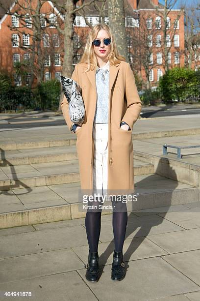 Fashion stylist Emily Outhwaite wears a Whistles top And Other Stories coat Topshop dress Russell and Bromley boots a vintage necklace and a Cos bag...