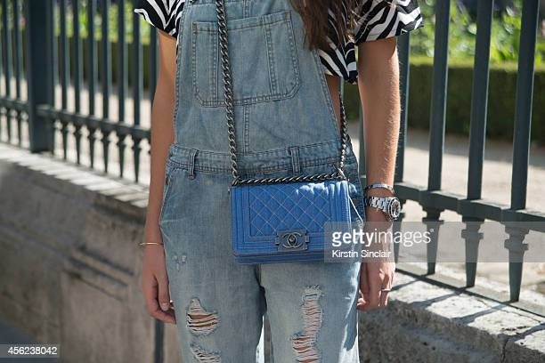 Fashion Stylist Estelle Pigauci is wearing Chanel bag Primark overalls and Misguided top on day 4 of Paris Collections Women on September 26 2014 in...