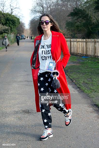 Fashion stylist Estelle Pigault wears a Ping He coat Chanel bag Pipalin trousers Chanel shoes New Look sunglasses Brandy Melville Tshirt and Fendi...