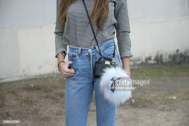 Fashion Stylist Estelle Pigault wears a vintage top and jeans and Fendi bag on day 6 during Paris Fashion Week Spring/Summer 2016/17 on October 4...