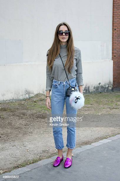 Fashion Stylist Estelle Pigault wears a vintage top and jeans Gucci shoes Fendi bag and Primark sunglasses on day 6 during Paris Fashion Week...