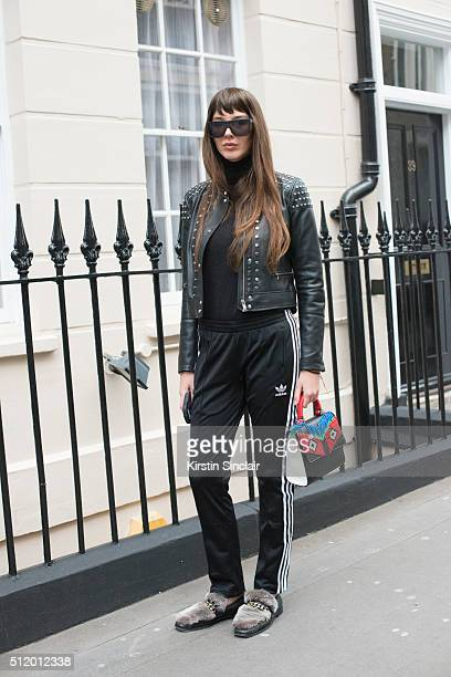 Fashion stylist Estelle Pigault wears Adidas tracksuit trousers Bershka jacket Boyy shoes Les Petits Joueurs bag and Quay sunglasses on day 5 during...