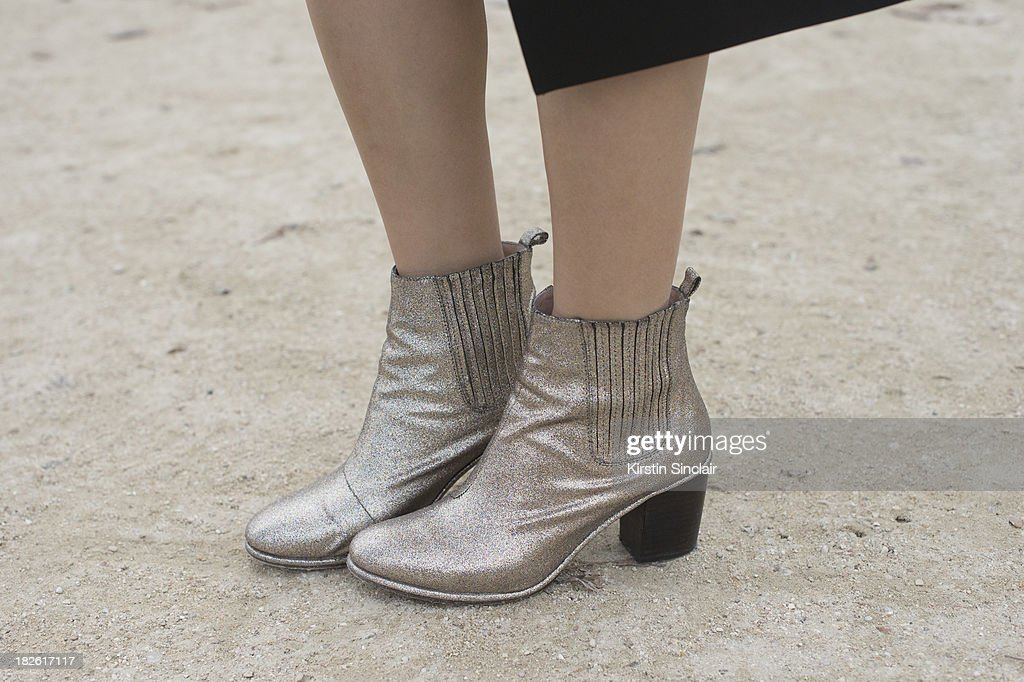 Fashion stylist Faye Tsui wears Opening Ceremony shoes on day 8 of Paris Fashion Week Spring/Summer 2014, Paris October 01, 2013 in Paris, France.