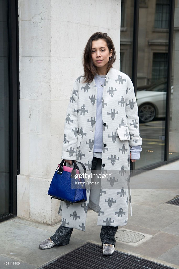 Fashion Stylist for Dutch Elle Magazine Nicole Huisman wears a Hope coat, Gucci shoes, Zara trousers and And Other Stories bag on February 21, 2015 in London, England.