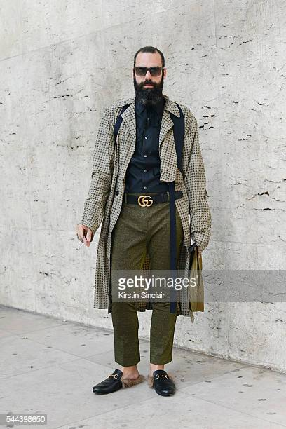 Fashion Stylist Graziano Di Cintio wears a Dries Van Noten coat Hugo Boss shirt and sunglasses Gucci shoes belt trousers and rings on day 3 of Paris...