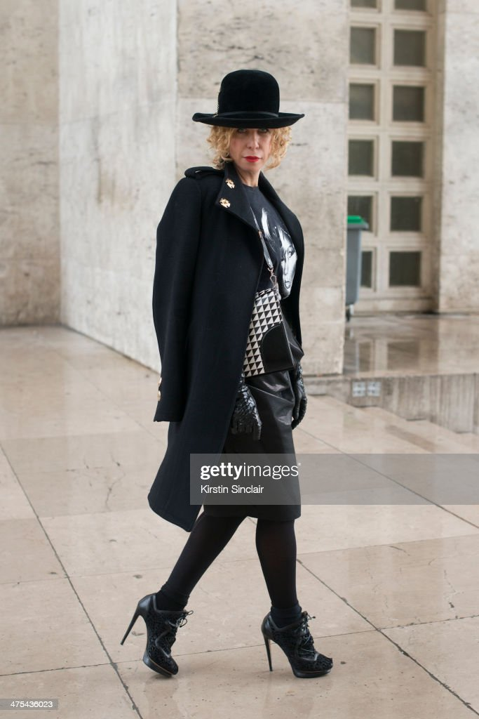 Fashion Stylist Laura Duncan wears a Proenza Schouler bag, Dita Von Teese gloves, Nicholas Kirkwood shoes, Vivienne Westwood skirt, vintage hat and top and Thomas Wylde coat on day 3 of Paris Collections: Women on February 27, 2014 in Paris, France.