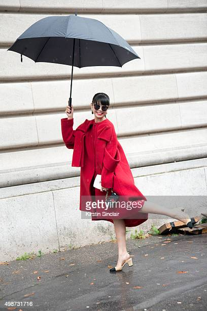 Fashion Stylist Leaf Greener wears a Delpozo coat Chanel bag and shoes and Emporio Armani sunglasses sunglasses on day 7 during Paris Fashion Week...
