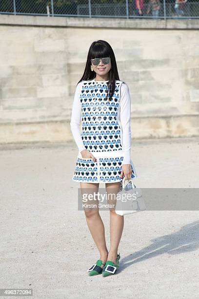 Fashion Stylist Leaf Greener wears a Delvaux bag Courreges jacket and dress Ms Min sweater Miu Miu heels and earrings Dior sunglasses and a Candies...