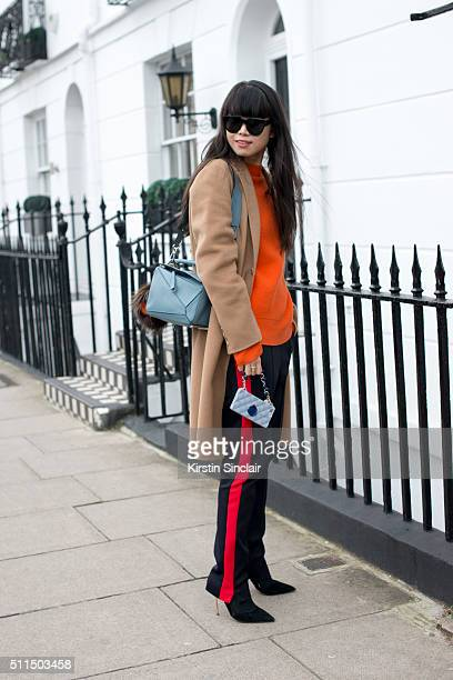 Fashion stylist Leaf Greener wears a Joseph coat and trousers AM Eyewear sunglasses Kurt Geiger shoes and Loewe bag on day 2 during London Fashion...