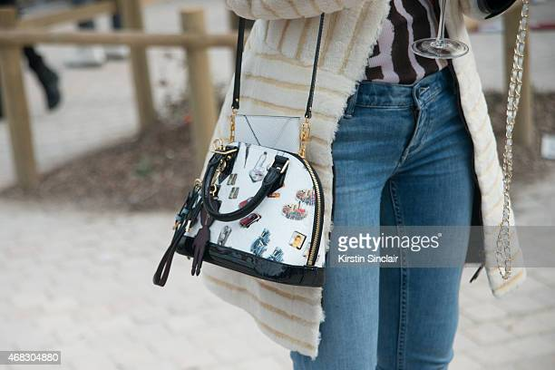 Fashion stylist Leaf Greener wears all Louis Vuitton with Calvin Klein jeanson day 9 of Paris Collections Women on March 11 2015 in Paris France