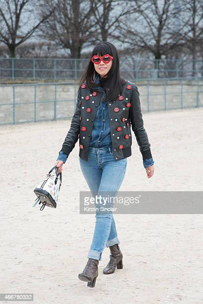 Fashion stylist Leaf Greener wears Calvin Klein jeans Yazbukey jacket and sunglasses Louis Vuitton shoes and bag and Brunello Cucinelli shirt on day...