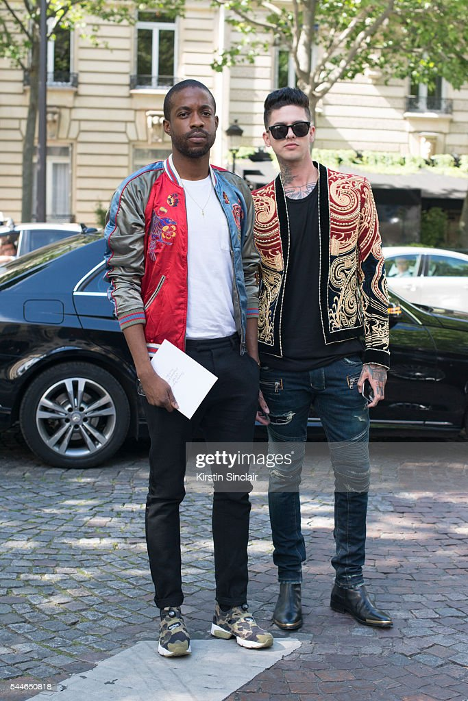 Fashion Stylist Manny Ezugwu wearing a Louis Vuitton bomber jacket with Singer Travis Mills wearing all Balmain on day 4 of Paris Collections Men on...