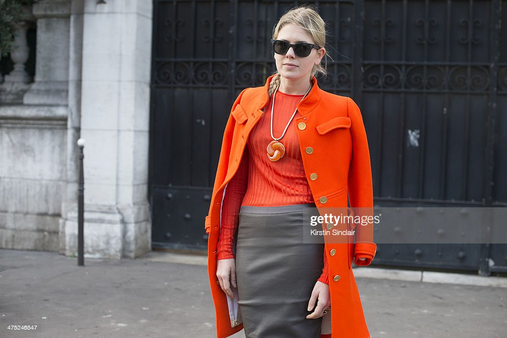 Fashion Stylist Megan Gray wears a Courreges coat, Rick Owens skirt, Wolford stockings, Oliver Peoples sunglasses and Celine sweater on day 2 of Paris Collections: Women on February 26, 2014 in Paris, France.