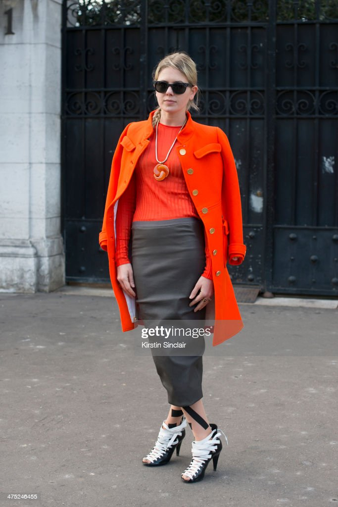 Fashion Stylist Megan Gray wears Balenciaga shoes, Courreges coat, Rick Owens skirt, Wolford stockings, Oliver Peoples sunglasses and Celine sweater on day 2 of Paris Collections: Women on February 26, 2014 in Paris, France.