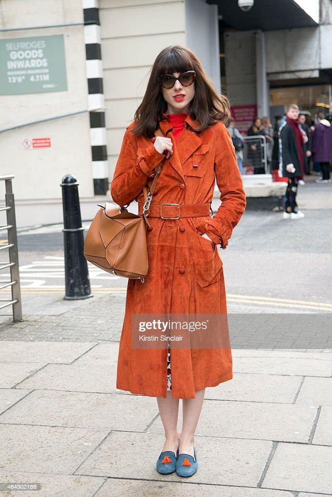 Fashion stylist Natalia wears a Loewe coat and bag Bylarin shoes Prada sunglasses and Bimba Y Lola skirt on February 23 2015 in London England