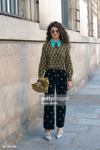 Fashion Stylist Nina Tiari wears a Miu Miu top Maison Margiela trousers Miu Miu shoes Jil Sander bag and Dior sunglasses on day 2 during Paris...