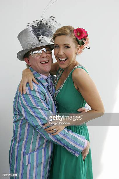 Fashion stylist Peter Jago and TV personality Catriona Rowntree pose during The Age Caulfield Guineas Day the first day of the Caulfield Spring...