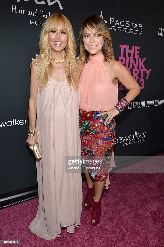 Fashion stylist Rachel Zoe (L) and Pink Party Founder <a gi-track='captionPersonalityLinkClicked' href=/galleries/search?phrase=Elyse+Walker&family=editorial&specificpeople=4361259 ng-click='$event.stopPropagation()'>Elyse Walker</a> attend <a gi-track='captionPersonalityLinkClicked' href=/galleries/search?phrase=Elyse+Walker&family=editorial&specificpeople=4361259 ng-click='$event.stopPropagation()'>Elyse Walker</a> Presents The Pink Party 2013 hosted by Anne Hathaway at Barker Hangar on October 19, 2013 in Santa Monica, California.