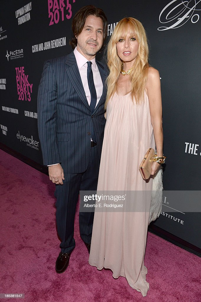 Fashion stylist Rachel Zoe (R) and <a gi-track='captionPersonalityLinkClicked' href=/galleries/search?phrase=Rodger+Berman&family=editorial&specificpeople=4104059 ng-click='$event.stopPropagation()'>Rodger Berman</a> attend Elyse Walker Presents The Pink Party 2013 hosted by Anne Hathaway at Barker Hangar on October 19, 2013 in Santa Monica, California.