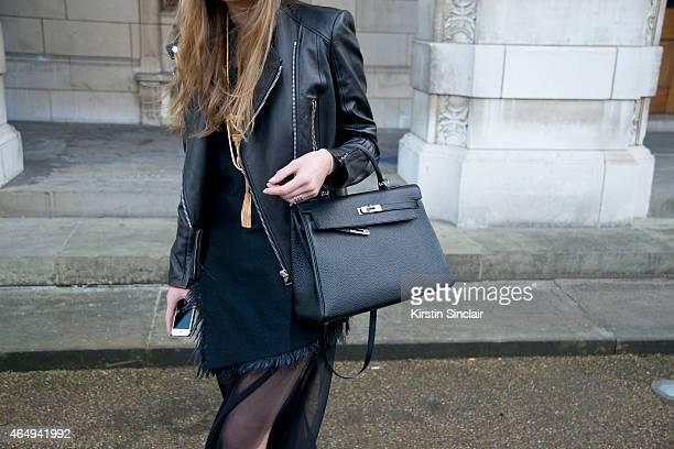 Fashion stylist Stephanie Stola wears a Hermes bag Marques Almeida jacket and dress Tom Ford jacket and Saint Laurent Jewellery on February 24 2015...