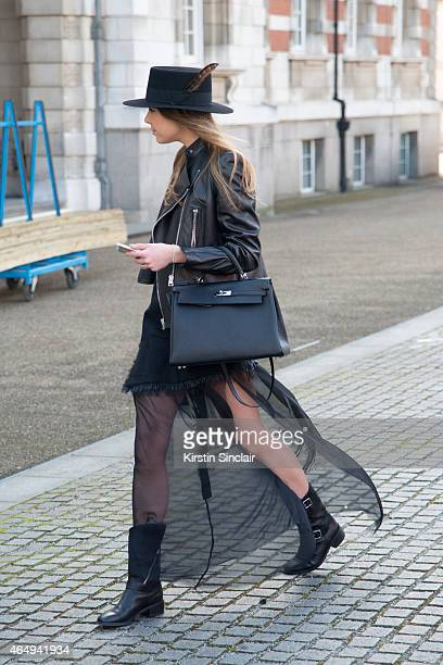 Fashion stylist Stephanie Stola wears an Yves Saint Laurent hat Hermes bag Marques Almeida jacket dress and boots Tom Ford jacket and Saint Laurent...