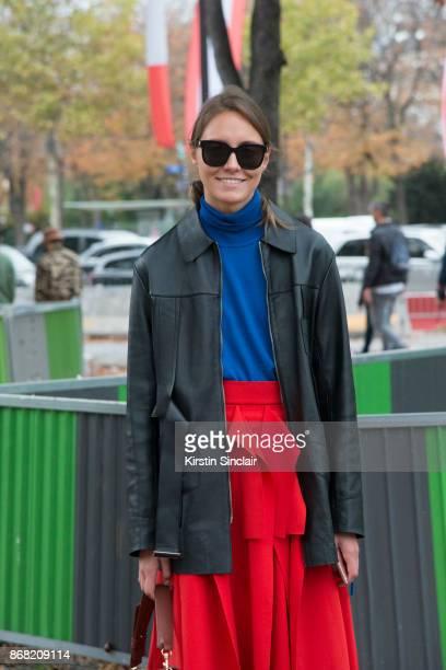 Fashion stylist Tess Yopp wears a Wooyoungmi jacket AWAKE skirt Gucci sweater and sunglasses day 3 of Paris Womens Fashion Week Spring/Summer 2018 on...