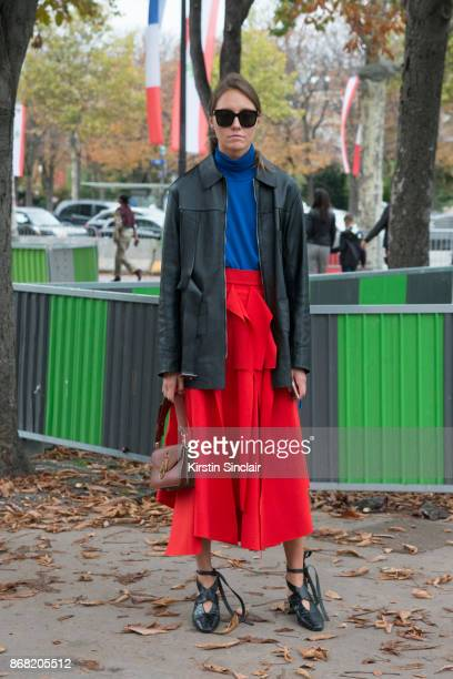 Fashion stylist Tess Yopp wears a Wooyoungmi jacket AWAKE skirt JW Anderson shoes and bag Gucci sweater and sunglasses day 3 of Paris Womens Fashion...