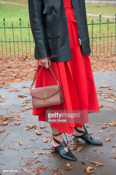 Fashion stylist Tess Yopp wears a Wooyoungmi jacket AWAKE skirt JW Anderson shoes and bag and a Gucci sweater day 3 of Paris Womens Fashion Week...