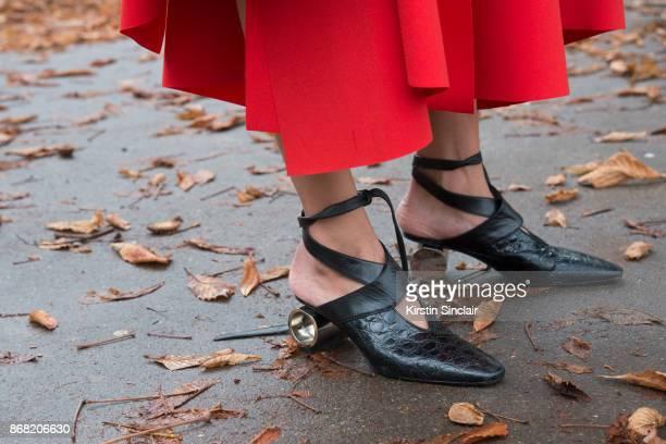 Fashion stylist Tess Yopp wears an AWAKE skirt JW Anderson shoes day 3 of Paris Womens Fashion Week Spring/Summer 2018 on September 28 2017 in London...