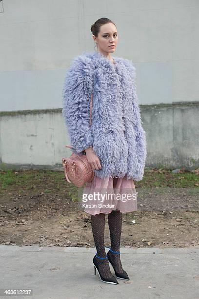 Fashion stylist Tess Yopp wears Dior shoes Christopher Kane dress Emilio Pucci coat and a Vivienne Westwood bag day 4 of Paris Mens Fashion Week...