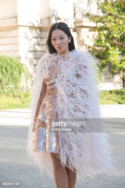 Fashion stylist Tina Leung wears a Monique L'Huillier jacket and dress day 2 of Paris Haute Couture Fashion Week Autumn/Winter 2017 on July 3 2017 in...