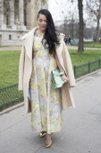 Fashion stylist Tina Leung wears a Rochas dress and clutch Celine coat and Guiseppe Zanotti shoes day 2 of Paris Haute Couture Fashion Week...