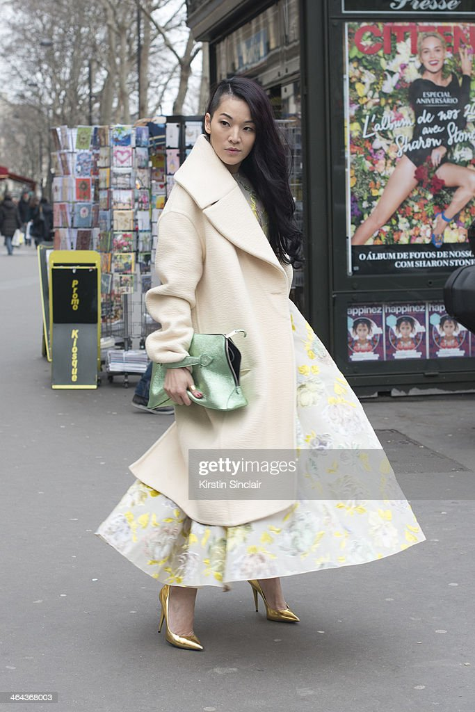 Fashion stylist Tina Leung wears a Rochas dress and clutch, Celine coat and Guiseppe Zanotti shoes day 2 of Paris Haute Couture Fashion Week Spring/Summer 2014, on January 21, 2014 in Paris, France.