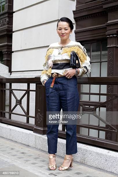 Fashion Stylist Tina Leung wears Phillip Lim jeans Balmain belt Dolce and Gabbana shoes Michael Kors shirt and Tom Ford sunglasses on day 1 of London...