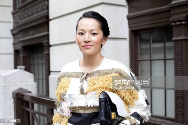Fashion Stylist Tina Leung wears Phillip Lim jeans Michael Kors shirt and Tom Ford sunglasses on day 1 of London Collections Men on June 15 2014 in...